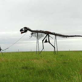Skeletal Man Walking His Dinosaur Statue by Breck Bartholomew