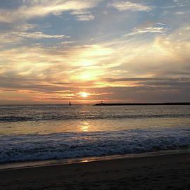 Sky Swirls Over Toes Beach by Lorraine Devon Wilke