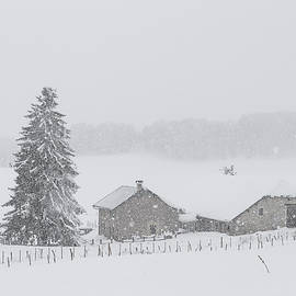 Snow falls on the old farm by Paul MAURICE