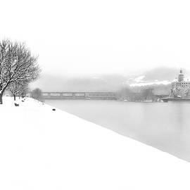 Snowfall On The River Danube At Ybbs by Menega Sabidussi