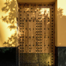 Soft Golden Shadows - Antique Door Fortified with Brass Studs Seville Spain by Georgia Mizuleva