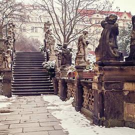 Jenny Rainbow - Staircase and Sculptures of Cherubs in Loreta Complex. Snowy Walk in Prague