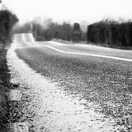Joe Fox - standing water on the edge of the road on a wet irish rural road in county sligo