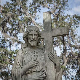 Statue of Jesus and Cross by Kim Hojnacki