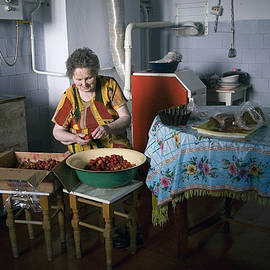 Stefania Cleans Strawberries in Chortkiw Ukraine by Yuri Lev