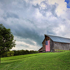 Storm Clouds Over Old Glory by John Vose
