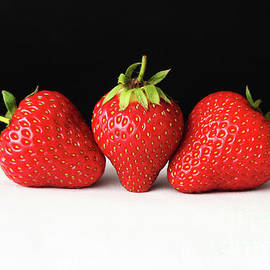 Alan Harman - Strawberries On Black Over White