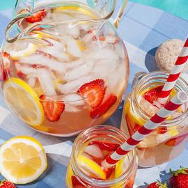 Strawberry lemonade at pool side 2 by Elena Elisseeva