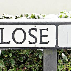 Street sign with snow - Tom Gowanlock