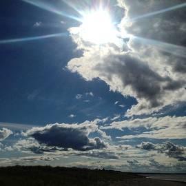 Sylvie Marie - Hope - Sun Burst Through Dark Clouds Over Sandy Beach