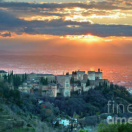 Sunrays over The alhambra Palace and Granada by Guido Montanes Castillo