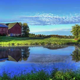 Sunrise Farm Pond Reflection by Dale Kauzlaric