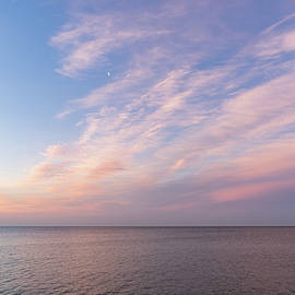 Georgia Mizuleva - Sunrise Moonset - Feathery Clouds and Crescent Moon over Water