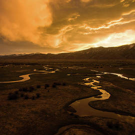 Sunrise Over Winding Rivers by Wesley Aston