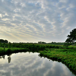 Ray Mathis - Sunrise Reflection of Clouds in Nippersink Creek
