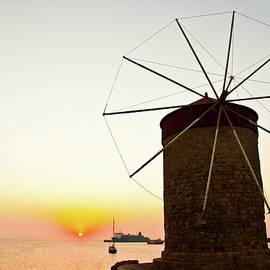 Sunrise, windmill and sea by Anna Kluba