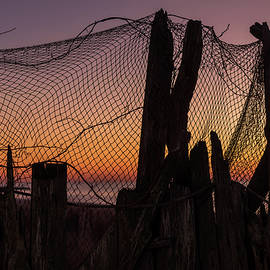 Sunset And Fishing Net Cape May New Jersey by Terry DeLuco