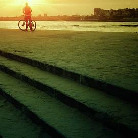 Sunset Bicycle Ride by Carlos Caetano