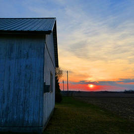 Tina M Wenger - Sunset By The Barn Wall