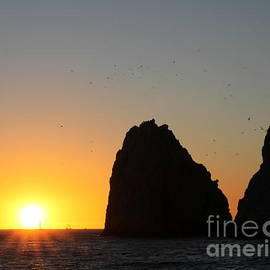 Sunset Cabo Sab Lucas with sailboats by Charlene Cox
