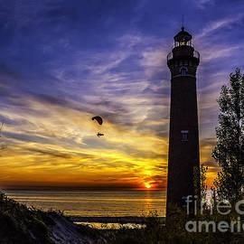 Nick Zelinsky - Sunset Flyer at the Light