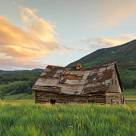 Sunset Over An Abandoned Cabin