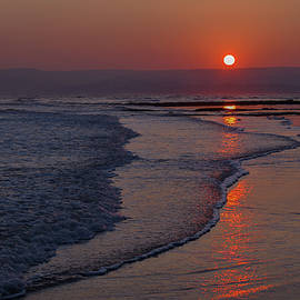 Sunset Over Exmouth Beach by Pete Hemington