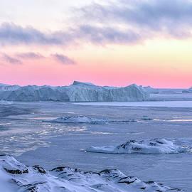 sunset over icebergs Ilulissat - Greenland - Joana Kruse