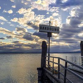 Yevhenii Volchenkov - Sunset over pier at lake Garda in Bardolino Italy