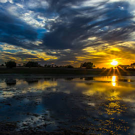 Sunset Over The Lake by Bob Marquis