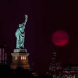 Super Moon Rising And The Statue Of Liberty by Alissa Beth Photography