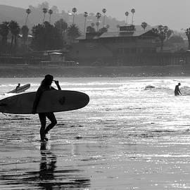 Surfing At Ventura Beach by Dan Friend