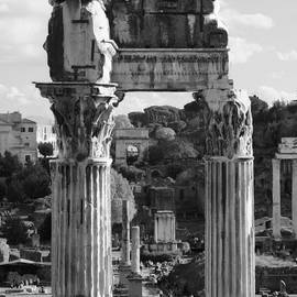Temple Of Saturn Ruins In Black And White by Angela Rath