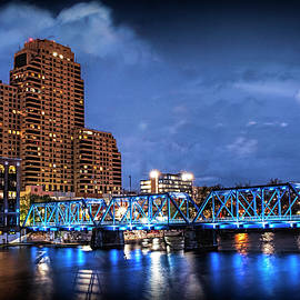 The Blue Walking Bridge at Night in Grand Rapids by Randall Nyhof