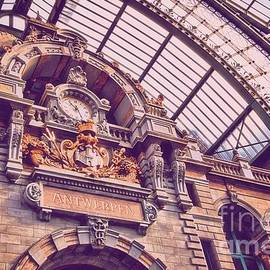 Camelia C - The clock at the upper level of the railway station from Antwerp