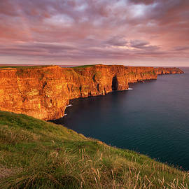 The Iconic Cliffs of Moher at sunset on the west coast of Ireland by Pierre Leclerc Photography