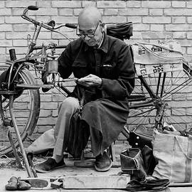 The Shoe Mender by Nigel Fletcher-Jones