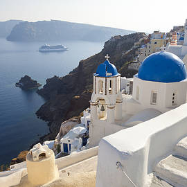 Peter Adams - The Village Of Oia Santorini, Cyclades, Greece
