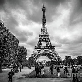 Tourists and Eiffel Tower at Champ de Mars, Paris by Liesl Walsh