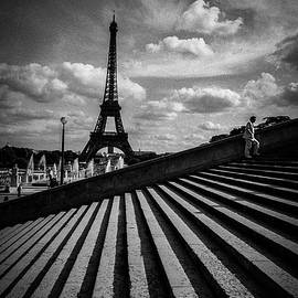 The stair way to Haven ,Trocadero Eiffel tower and a man. by Cyril Jayant