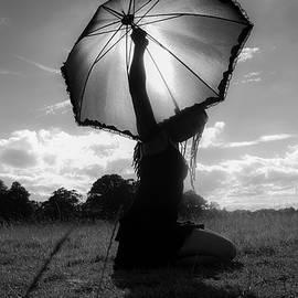 Umbrella on the sun by Victor Vega