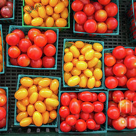 Various Type And Colors Of Small Tomatos In Small Plastic Basket by PorqueNo Studios