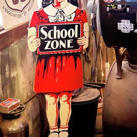 Tatiana Travelways - Vintage school zone sign