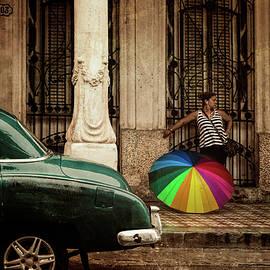 Waiting Out The Rain in Havana Cuba by Joan Carroll