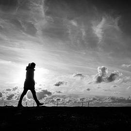 Giuseppe Milo - Walking alone - Howth, Ireland - Black and white street photography