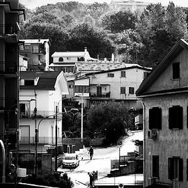 Giuseppe Milo - Walking the dog - Paola, Italy - Black and white street photography