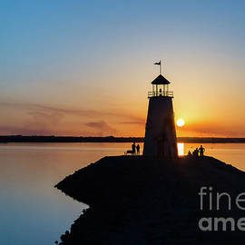 Paul Quinn - Watching the sunset under the lighthouse