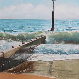 Waves with beach groin