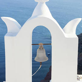 Antonio Gravante - White bell tower at Oia, Santorini, Greece.