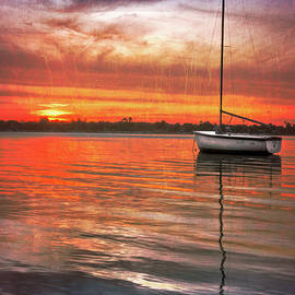 White Boat at Sunset by Debra and Dave Vanderlaan